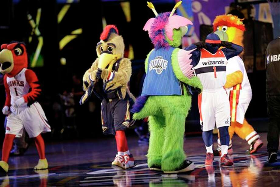 NBA mascots walk on the court before the NBA All Star basketball game, Sunday, Feb. 16, 2014, in New Orleans. (AP Photo/Gerald Herbert) Photo: Gerald Herbert, AP / AP