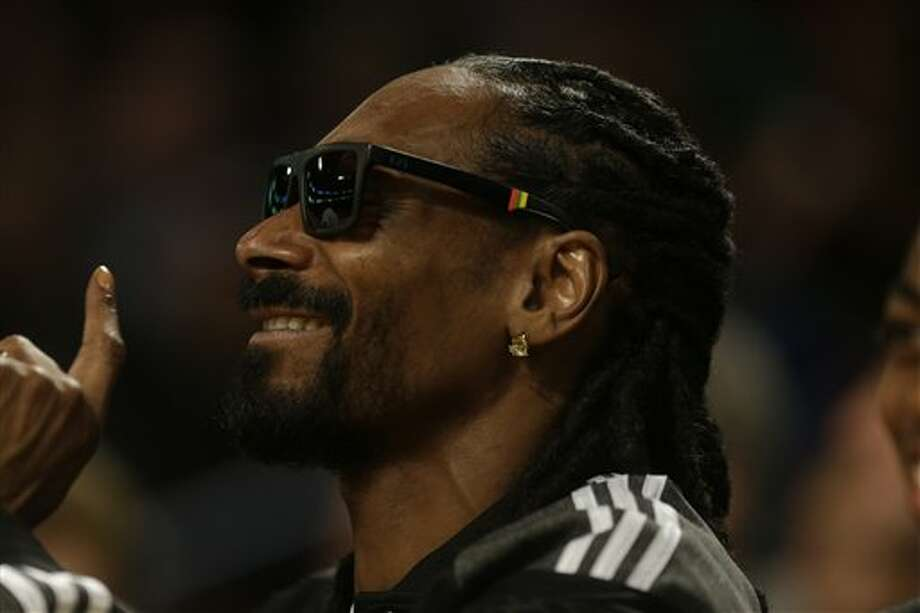 Rapper Snoop Dog greets fans during the NBA All Star basketball game, Sunday, Feb. 16, 2014, in New Orleans. (AP Photo/Gerald Herbert) Photo: Gerald Herbert, AP / AP