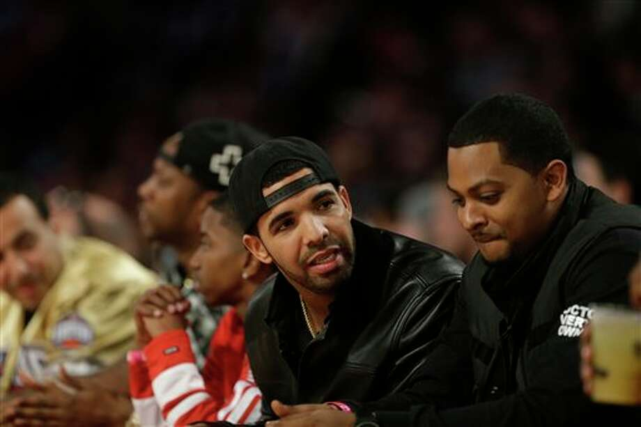 Rapper Drake watches play during the NBA All Star basketball game, Sunday, Feb. 16, 2014, in New Orleans. (AP Photo/Gerald Herbert) Photo: Gerald Herbert, AP / AP
