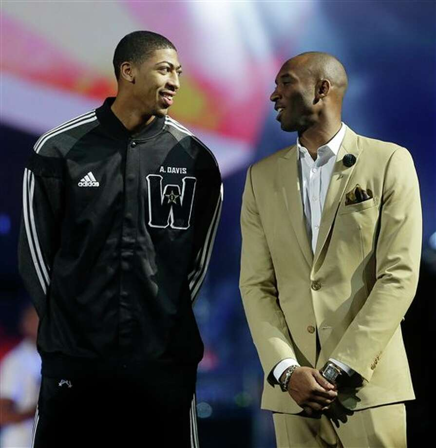 West Team's Anthony Davis, of the New Orleans Pelicans , left, speaks with Los Angeles Lakers Kobe Bryant during the NBA All Star basketball game, Sunday, Feb. 16, 2014, in New Orleans. (AP Photo/Gerald Herbert) Photo: Gerald Herbert, AP / AP