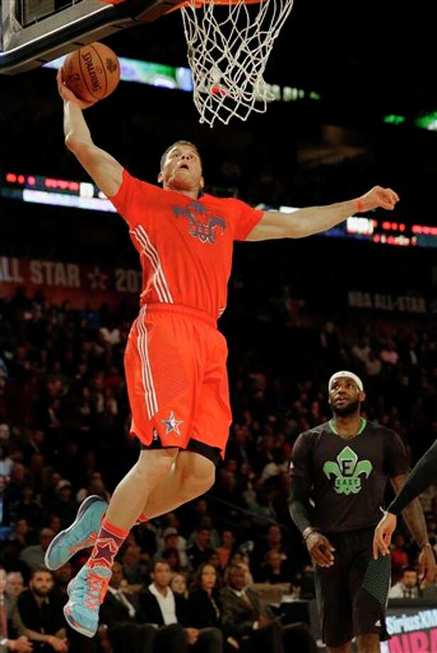 West Team's Blake Griffin, of the Los Angeles Clippers (32) heads to the hoop as East Team's LeBron James, of the Miami Heat (6) looks on during the NBA All Star basketball game, Sunday, Feb. 16, 2014, in New Orleans. (AP Photo/Gerald Herbert) Photo: Gerald Herbert, AP / AP