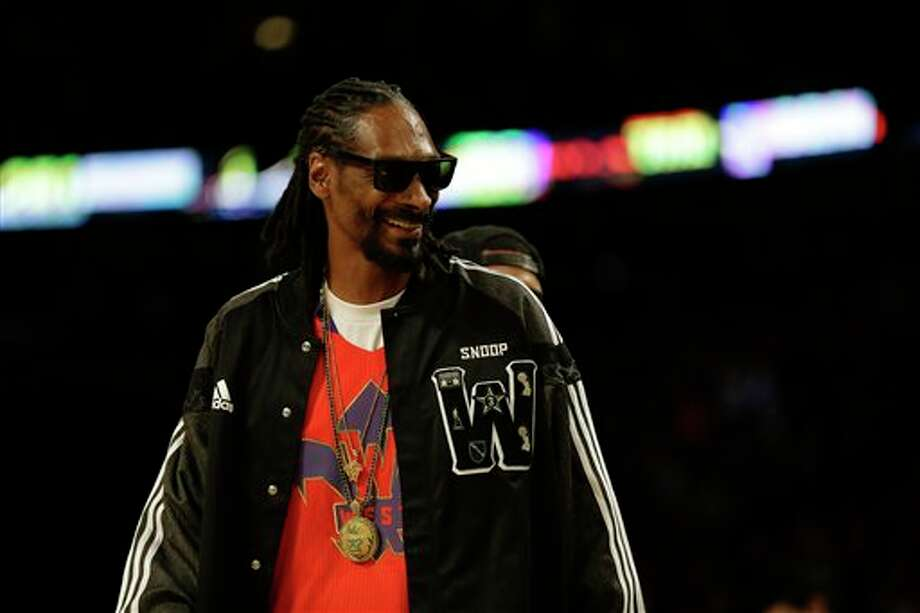 Rapper Snoop Dog walks on the court during the NBA All Star basketball game, Sunday, Feb. 16, 2014, in New Orleans. (AP Photo/Gerald Herbert) Photo: Gerald Herbert, AP / AP