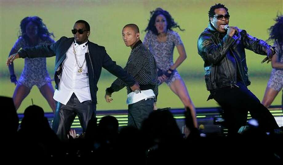 Rappers P Diddy, Pharrell Williams and Busta Rhymes perform during the NBA All Star basketball game, Sunday, Feb. 16, 2014, in New Orleans. (AP Photo/Gerald Herbert) Photo: Gerald Herbert, AP / AP