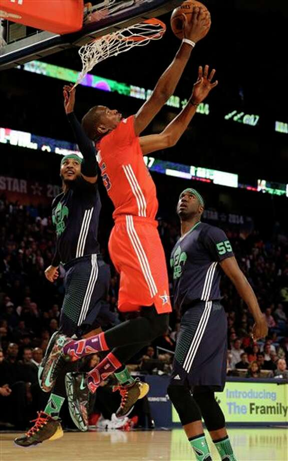 West Team's Kevin Durant, of the Oklahoma City Thunder (35) goes to the hoop against Team east during the NBA All Star basketball game, Sunday, Feb. 16, 2014, in New Orleans. (AP Photo/Gerald Herbert) Photo: Gerald Herbert, AP / AP