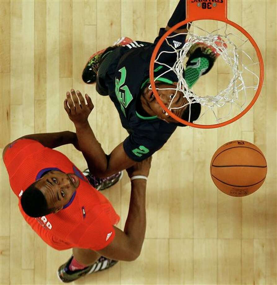 West Team Dwight Howard, of the Houston Rockets (12) and East Team John Wall, of the Washington Wizards (2) vie for a loose ball during the NBA All Star basketball game, Sunday, Feb. 16, 2014, in New Orleans. (AP Photo/Gerald Herbert) Photo: Gerald Herbert, AP / AP