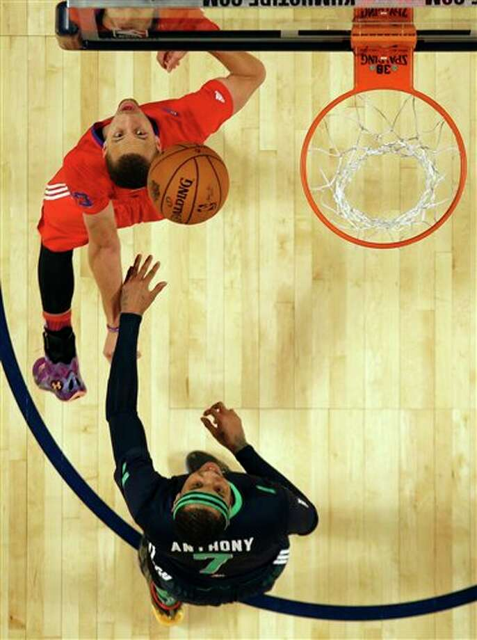 West Team's Stephen Curry, of the Golden State Warriors, left and East Team's Carmelo Anthony, of the New York Knicks (7) watch a ball  during the NBA All Star basketball game, Sunday, Feb. 16, 2014, in New Orleans. (AP Photo/Gerald Herbert) Photo: Gerald Herbert, AP / AP