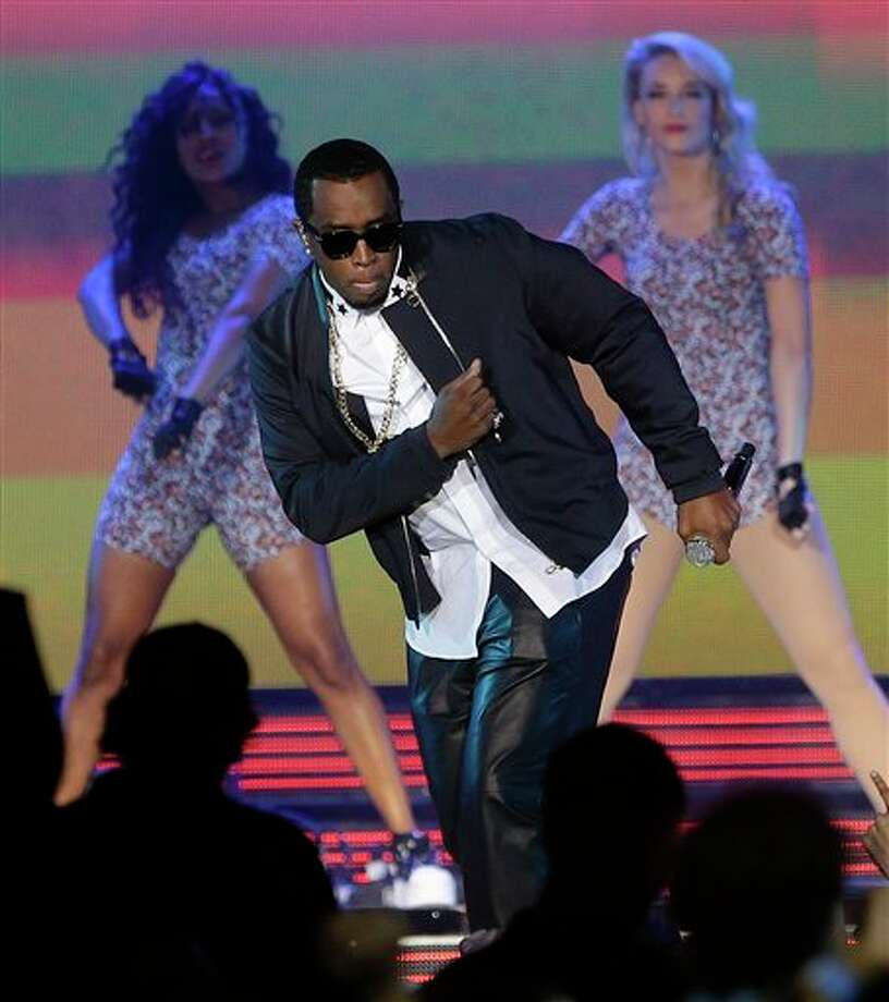 Rapper P Diddy performs during the NBA All Star basketball game, Sunday, Feb. 16, 2014, in New Orleans. (AP Photo/Gerald Herbert) Photo: Gerald Herbert, AP / AP