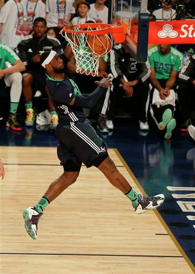 East Team's LeBron James, of the Miami Heat (6) dunks the ball against the West Team during the NBA All Star basketball game, Sunday, Feb. 16, 2014, in New Orleans. (AP Photo/Bill Haber) Photo: Bill Haber, AP / FR170136 AP