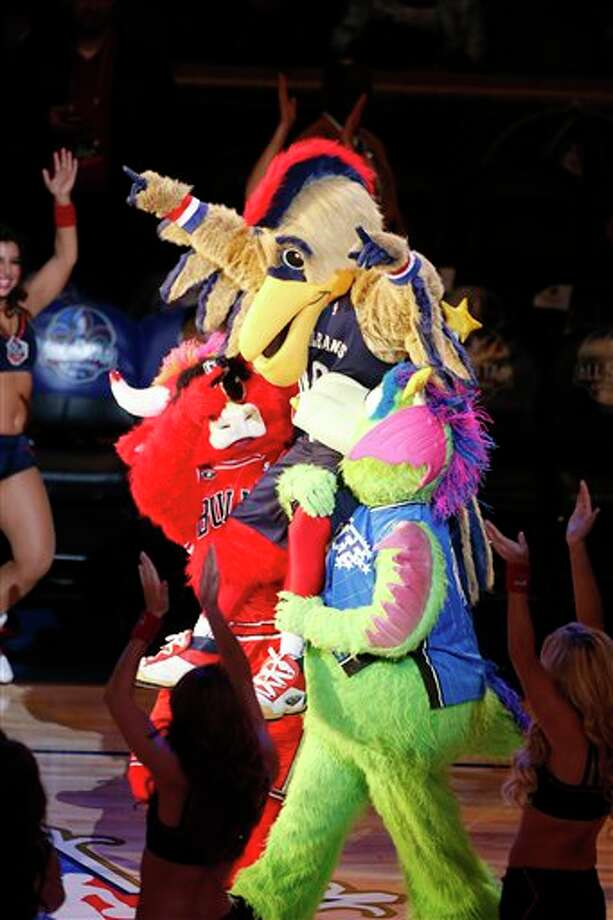 NBA mascots walk on the court before the NBA All Star basketball game, Sunday, Feb. 16, 2014, in New Orleans. (AP Photo/Bill Haber) Photo: Bill Haber, AP / FR170136 AP