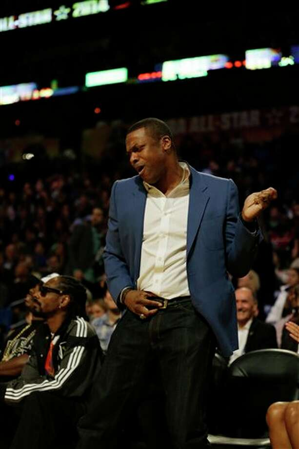 Actor Chris Tucker dances during the NBA All Star basketball game, Sunday, Feb. 16, 2014, in New Orleans. (AP Photo/Gerald Herbert) Photo: Gerald Herbert, AP / AP