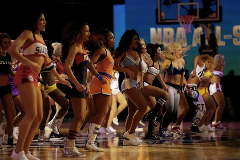 The NBA All Star Cheerleaders perform during the NBA All Star basketball game, Sunday, Feb. 16, 2014, in New Orleans. (AP Photo/Gerald Herbert) Photo: Gerald Herbert, AP / AP