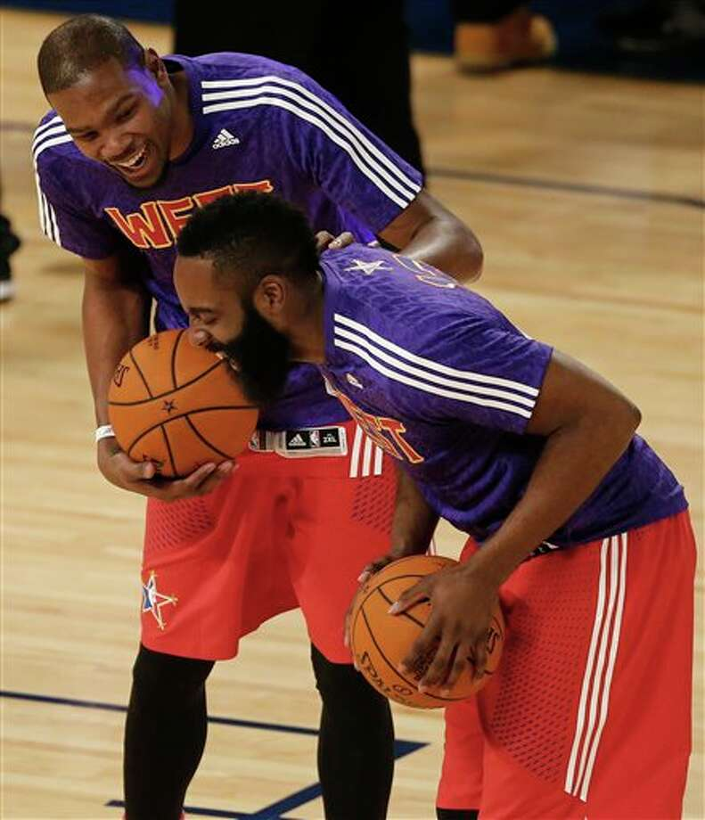 West Team's Kevin Durant, of the Oklahoma City Thunder, left, and James Harden, of the Houston Rockets laugh before the NBA All Star basketball game, Sunday, Feb. 16, 2014, in New Orleans. (AP Photo/Bill Haber) Photo: Bill Haber, AP / FR170136 AP