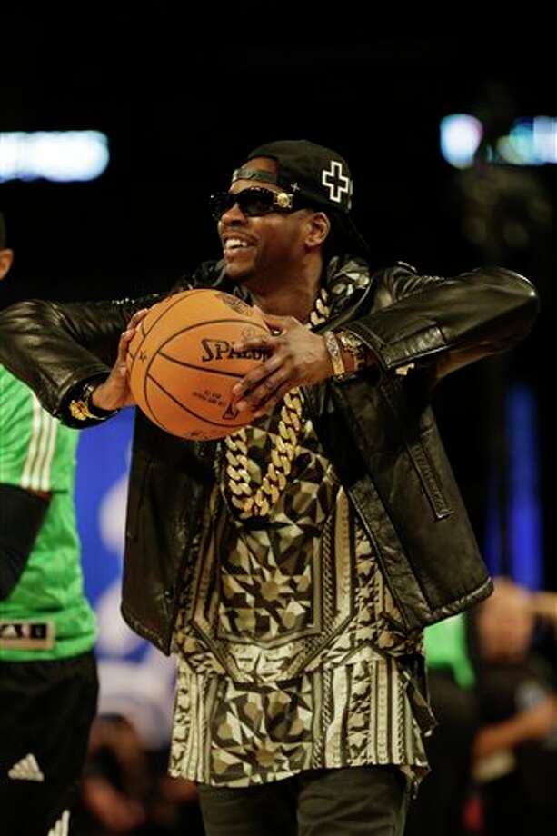 Rapper 2 Chainz, walks on the court before the NBA All Star basketball game, Sunday, Feb. 16, 2014, in New Orleans. (AP Photo/Gerald Herbert) Photo: Gerald Herbert, AP / AP