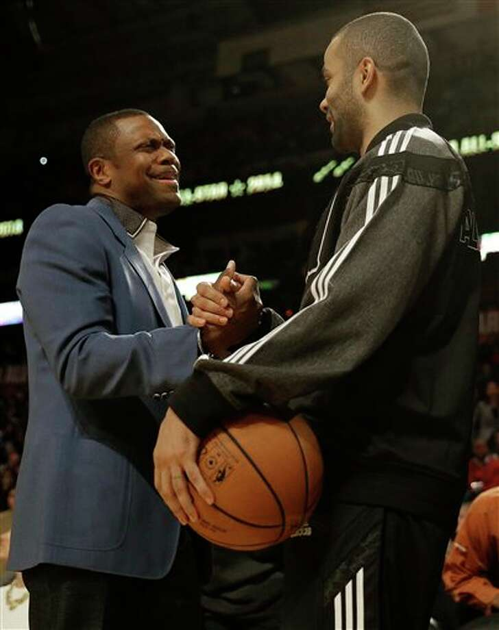 Actor Chris Tucker, left and West Team's Tony Parker, of the San Antonio Spurs speak before the NBA All Star basketball game, Sunday, Feb. 16, 2014, in New Orleans. (AP Photo/Gerald Herbert) Photo: Gerald Herbert, AP / AP