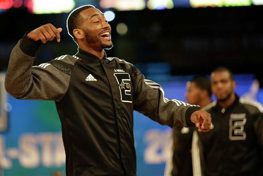 East Team's John Wall, of the Washington Wizards walks the floor before the NBA All Star basketball game, Sunday, Feb. 16, 2014, in New Orleans. (AP Photo/Gerald Herbert) Photo: Gerald Herbert, AP / AP