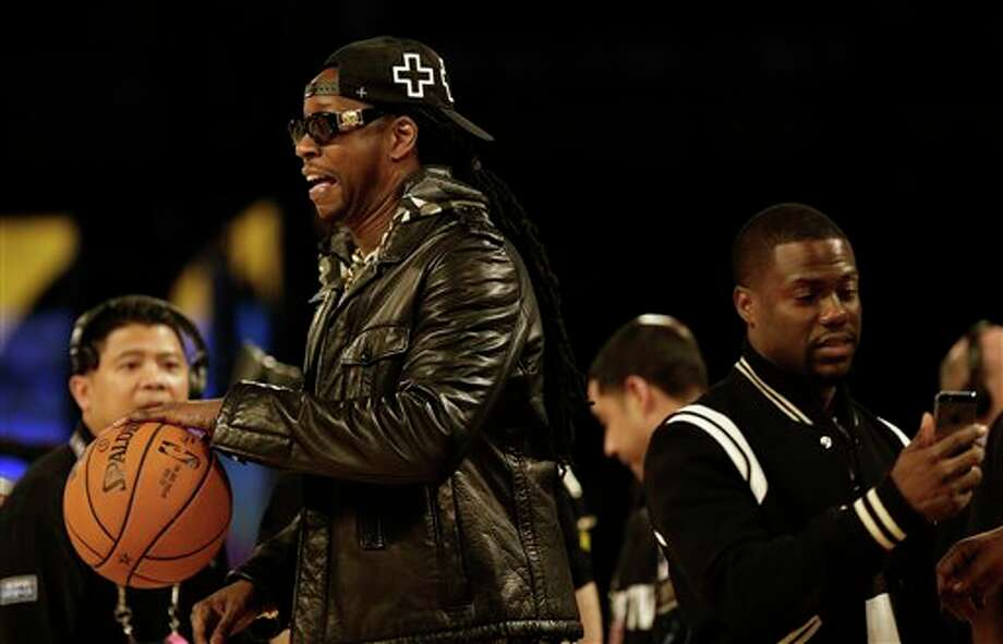 Rapper 2 Chainz, right, and Actor Kevin Hart walk on the floor before during the NBA All Star basketball game, Sunday, Feb. 16, 2014, in New Orleans. (AP Photo/Gerald Herbert) Photo: Gerald Herbert, AP / AP