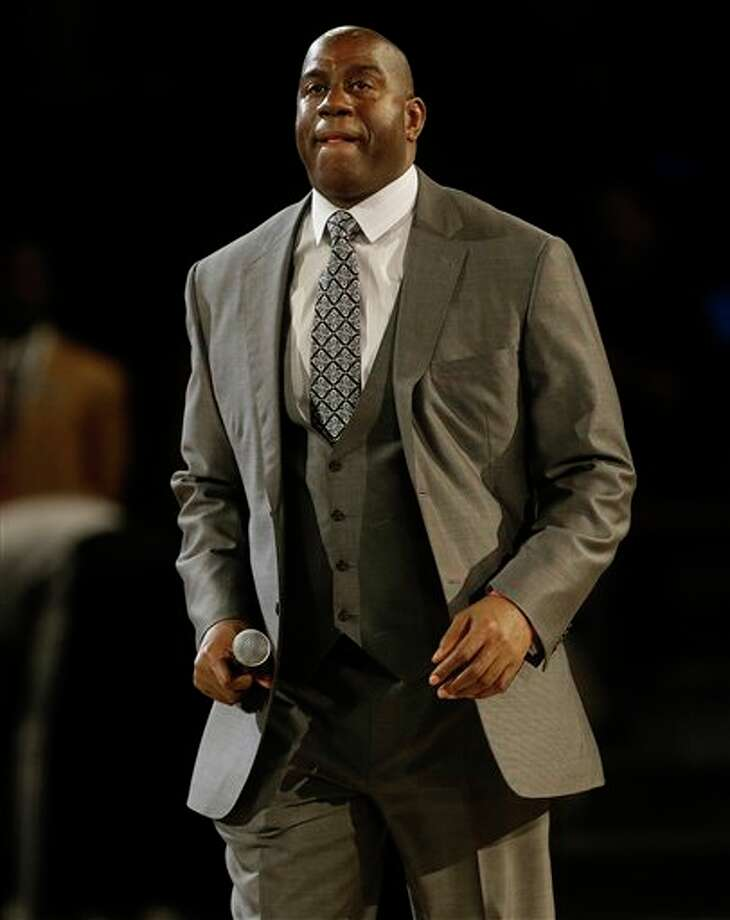 "Former NBA player Earvin ""Magic"" Johnson, Jr. walks on the court during the NBA All Star basketball game, Sunday, Feb. 16, 2014, in New Orleans. (AP Photo/Gerald Herbert) Photo: Gerald Herbert, AP / AP"