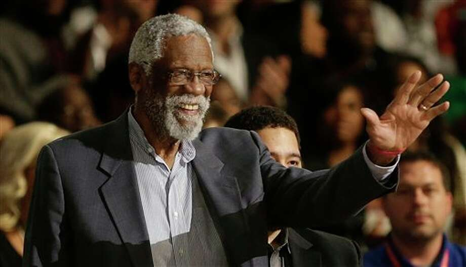 Former NBA player Bill Russell waves to the crowd during the NBA All Star basketball game, Sunday, Feb. 16, 2014, in New Orleans. (AP Photo/Gerald Herbert) Photo: Gerald Herbert, AP / AP