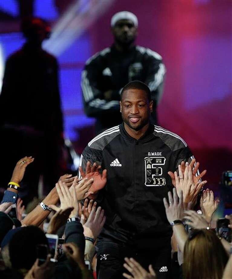 East Team's Dwyane Wade, of the Miami Heat takes the court before the NBA All Star basketball game, Sunday, Feb. 16, 2014, in New Orleans. (AP Photo/Gerald Herbert) Photo: Gerald Herbert, AP / AP