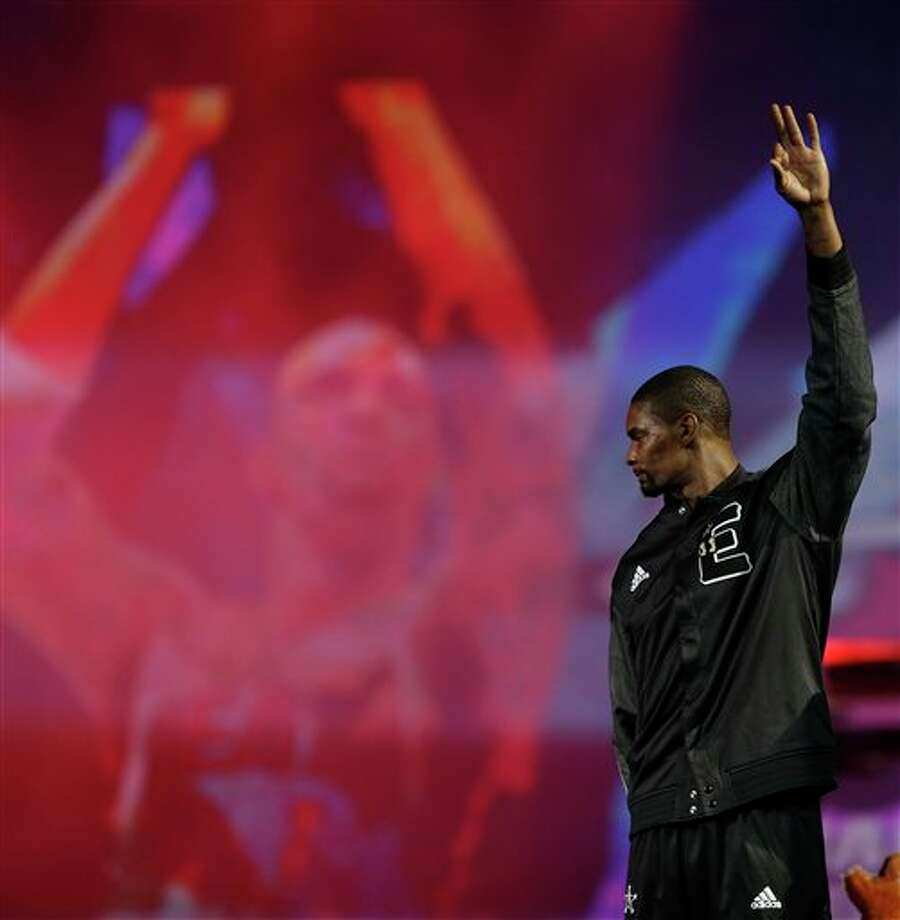 East Team's Chris Bosh, of the Miami Heat takes the court before the NBA All Star basketball game, Sunday, Feb. 16, 2014, in New Orleans. (AP Photo/Gerald Herbert) Photo: Gerald Herbert, AP / AP