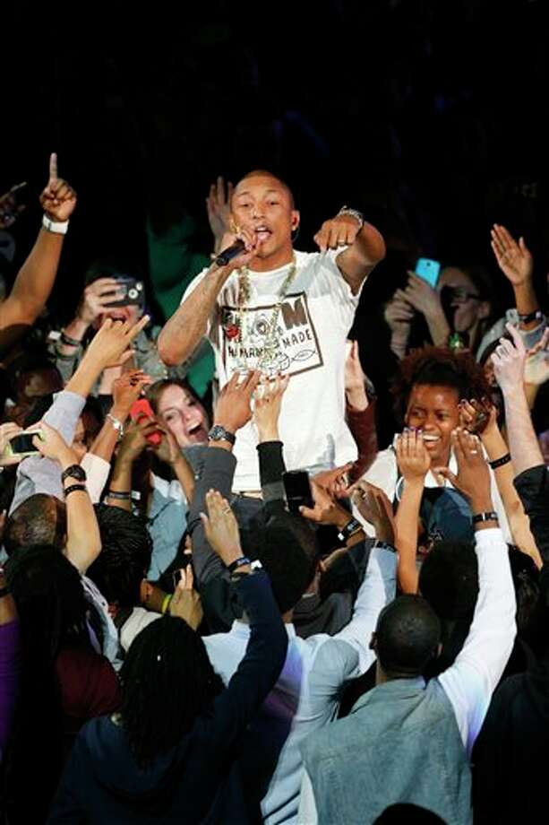 Rappers Pharrell Williams before the NBA All Star basketball game, Sunday, Feb. 16, 2014, in New Orleans. (AP Photo/Bill Haber) Photo: Bill Haber, AP / FR170136 AP