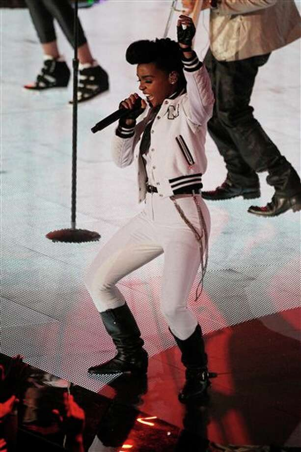 Singer Janelle Monáe performs during the NBA All Star basketball game, Sunday, Feb. 16, 2014, in New Orleans. (AP Photo/Bill Haber) Photo: Bill Haber, AP / FR170136 AP