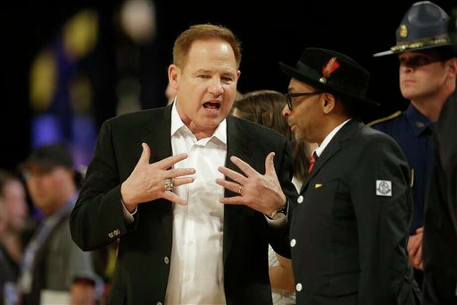 LSU Head football coach Les Miles, left, speaks with Director Spike Lee before the NBA All Star basketball game, Sunday, Feb. 16, 2014, in New Orleans. (AP Photo/Gerald Herbert) Photo: Gerald Herbert, AP / AP