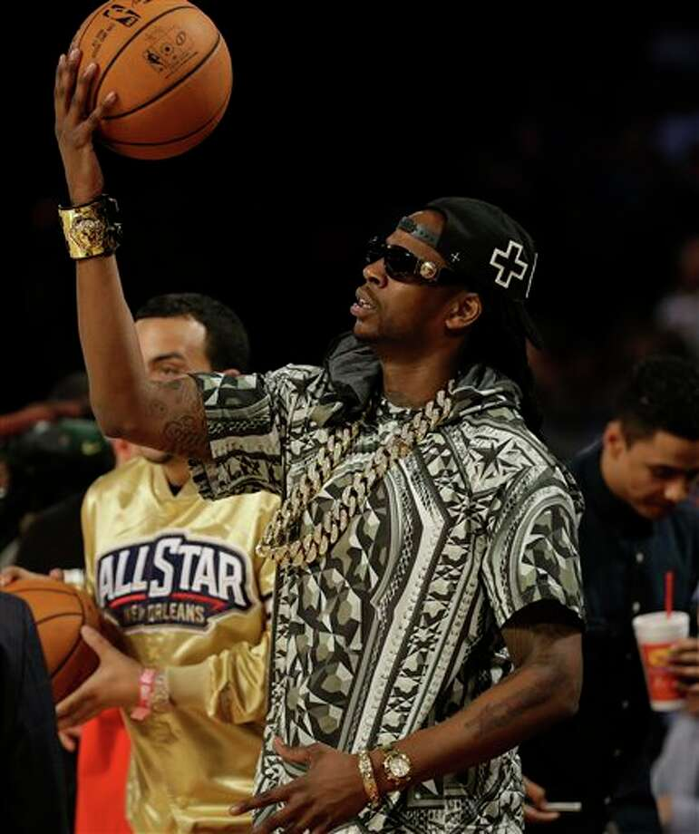Rapper 2 Chains plays with a ball during the NBA All Star basketball game, Sunday, Feb. 16, 2014, in New Orleans. (AP Photo/Gerald Herbert) Photo: Gerald Herbert, AP / AP