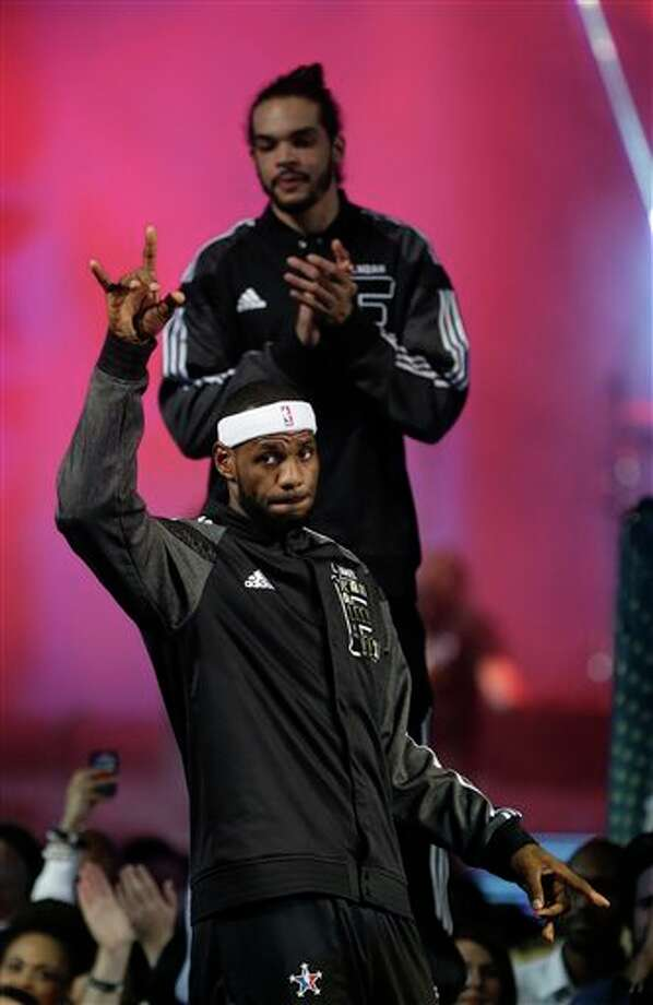 East Team's LeBron James, of the Miami Heat  East Team's Joakim Noah, of the Chicago Bulls takes the court before the NBA All Star basketball game, Sunday, Feb. 16, 2014, in New Orleans. (AP Photo/Gerald Herbert) Photo: Gerald Herbert, AP / AP