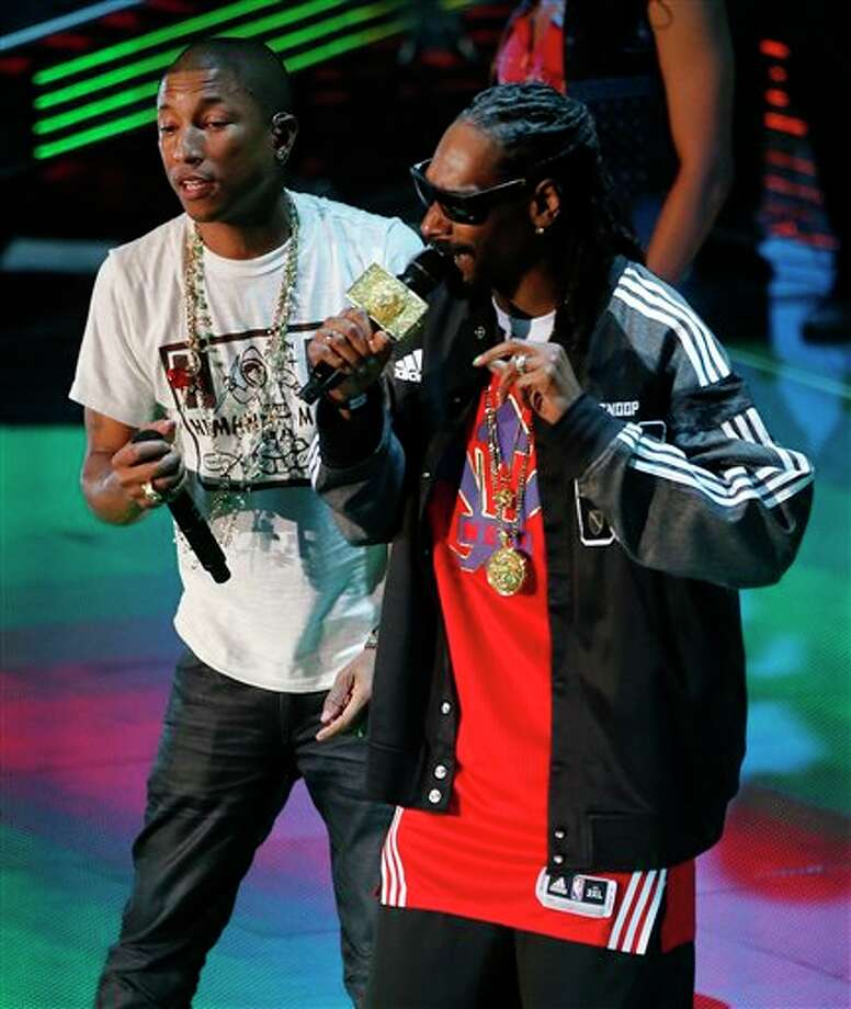 Rappers Pharrell Williams , left, and Snoop Dog perform before the NBA All Star basketball game, Sunday, Feb. 16, 2014, in New Orleans. (AP Photo/Bill Haber) Photo: Bill Haber, AP / FR170136 AP