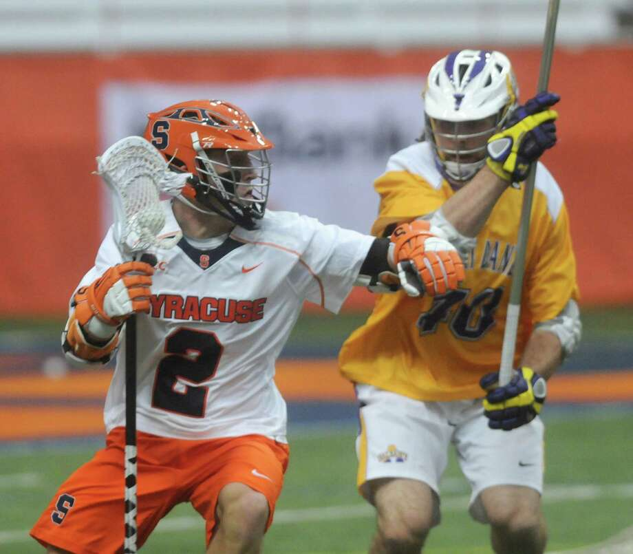 SU's Kevin Rice works around Albany defender Cody Futia in first quarter action at the Carrier Dome.  Mike Greenlar | mgreenlar ORG XMIT: 91191 Photo: Mike Greenlar