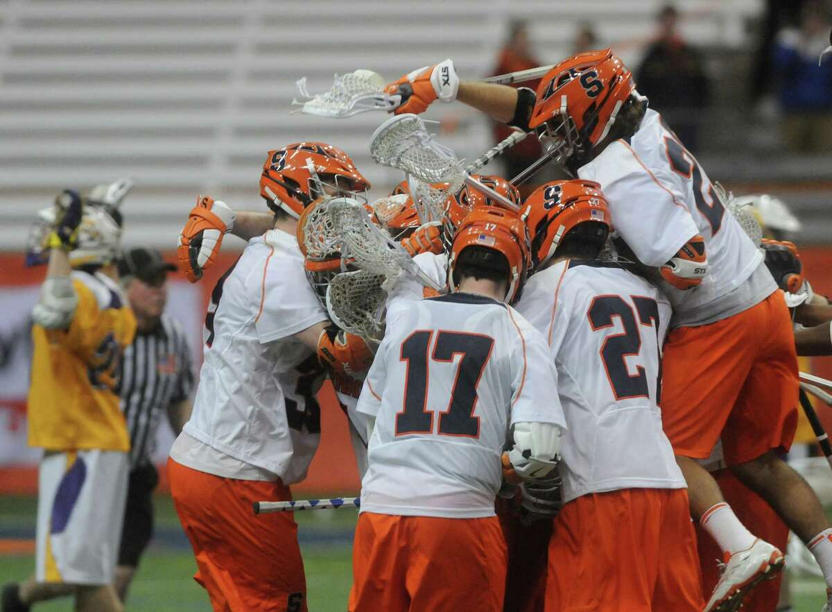 SU players celebrate 17-16 overtime win over Albany in the Carrier Dome Sunday night. Mike Greenlar   mgreenlar@syracuse.com ORG XMIT: 91191