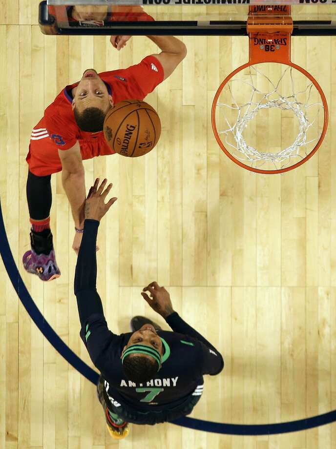 West Team's Stephen Curry, of the Golden State Warriors, left and East Team's Carmelo Anthony, of the New York Knicks (7) watch a ball  during the NBA All Star basketball game, Sunday, Feb. 16, 2014, in New Orleans. (AP Photo/Gerald Herbert) Photo: Gerald Herbert, Associated Press
