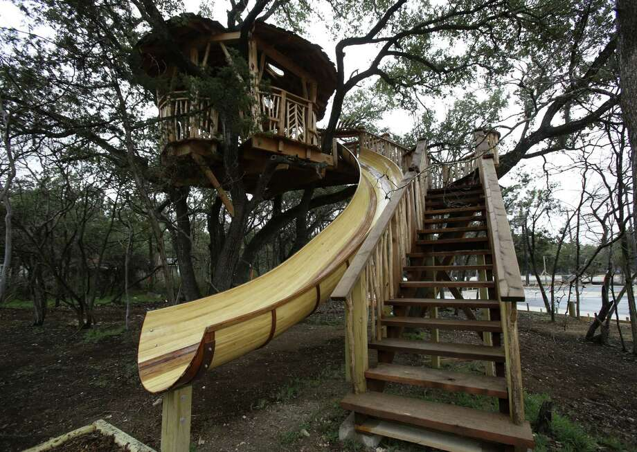 "A treehouse at the Anne Frank Inspire Academy was designed and built by Pete Nelson of Animal Planet's ""Treehouse Masters."" He said his crew's biggest source of pride in the project is the 26-foot-long slide. Photo: Photos By Helen L. Montoya / San Antonio Express-News / ©2013 San Antonio Express-News"