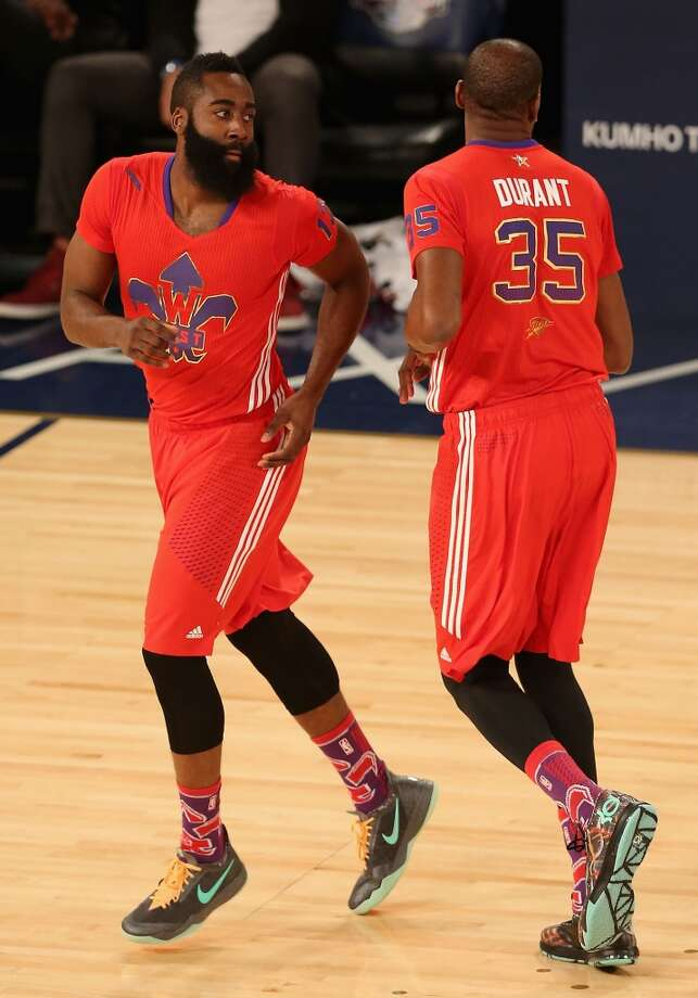 James Harden #13 of the Rockets and Kevin Durant #35 of the Thunder react after scoring. Photo: Christian Petersen, Getty Images