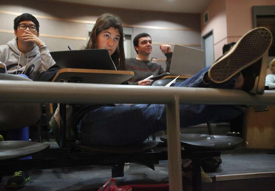UC Berkeley student Chandler Fitzsimons (center), with classmates Jongseon Park (left) and Darius Kay, attends the Beauty and Joy of Computing class, which enrolled more women than men for the first time. Photo: Leah Millis, The Chronicle