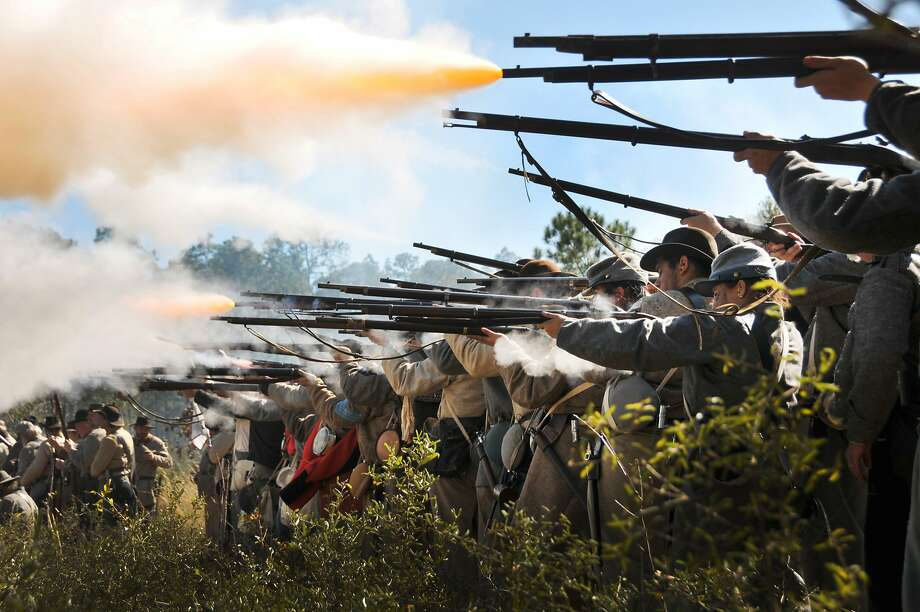 Point and shoot:Confederate soldiers fire on the blue bellies during a 150th anniversary re-enactment of the Battle of Olustee, the largest Civil War battle fought in Florida. Olustee was a relatively small engagement involving about 10,000 men, but a bloody one. The Union suffered 34 percent casualties. Photo: Will Dickey, Associated Press