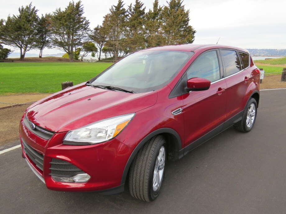 The 2014 Ford Escape comes with a choice of three different four-cylinder engines, and the one that came with our test vehicle was the 1.6-liter Ecoboost engine with 178 horsepower driving through a six-speed automatic transmission.  (All photos by Michael Taylor)