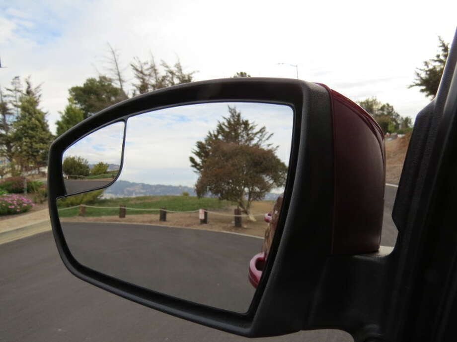 The outside mirror has a small inset mirror that enables the driver to better see overtaking cars.