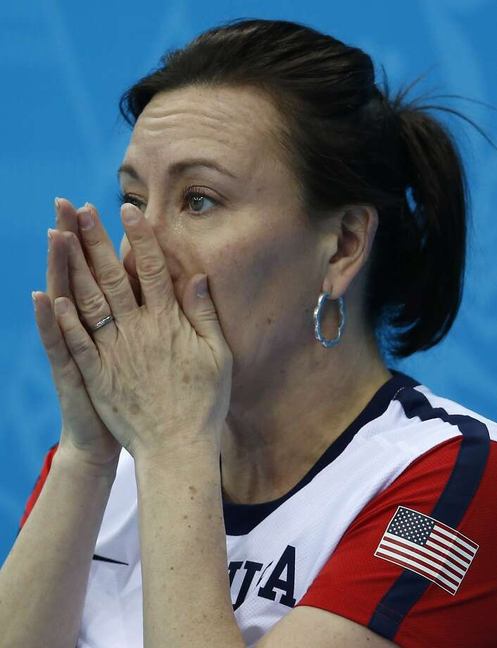 American Ann Swisshelm wipes away tears after losing to South Korea during women's curling competition against at the 2014 Winter Olympics, Monday, Feb. 17, 2014, in Sochi, Russia.  Photo: Robert F. Bukaty, Associated Press