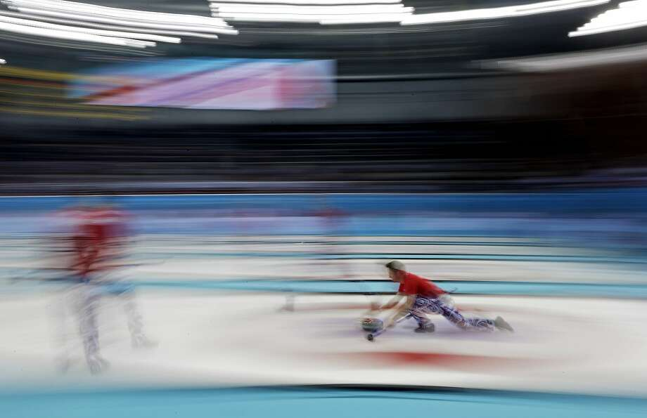 Norway's Torger Nergaard  delivers the rock to his sweepers during a round robin match against Denmark at the 2014 Winter Olympics, Monday, Feb. 17, 2014, in Sochi, Russia. Photo: Morry Gash, Associated Press