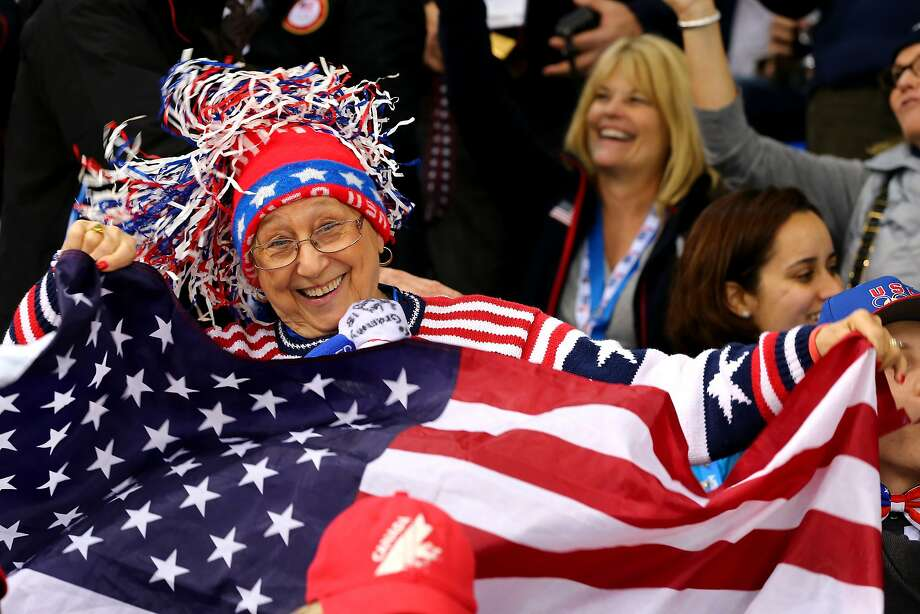 A United States  fan cheers in the crowd during the Women's Ice Hockey Playoffs Semifinal game against Sweden on day ten of the Sochi 2014 Winter Olympics at Shayba Arena on February 17, 2014 in Sochi, Russia. Photo: Martin Rose, Getty Images