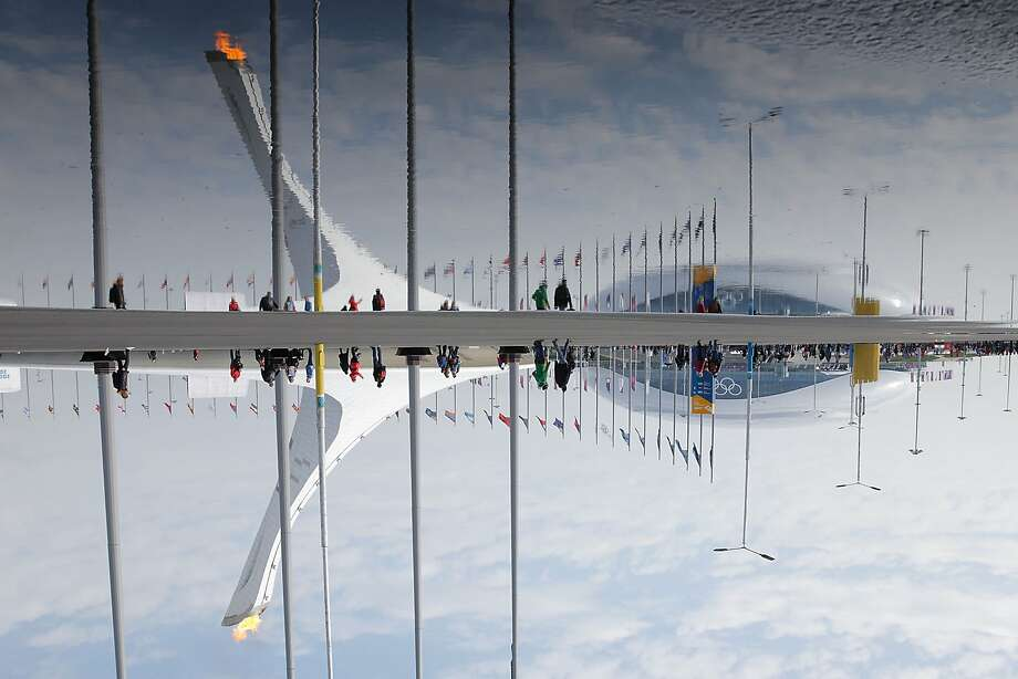 The Olympic Cauldron and Bolshoy Ice Dome are reflected in a puddle in the Olympic Park during the Sochi 2014 Winter Olympics on February 17, 2014 in Sochi, Russia. Photo: Joe Scarnici, Getty Images