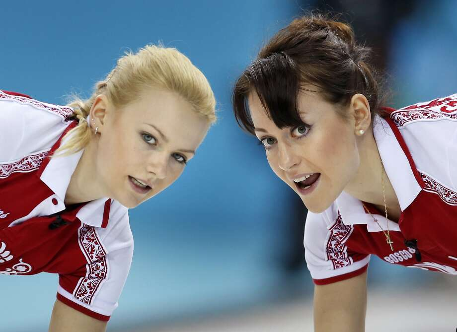 Russia's Alexandra Saitova, left, and Ekaterina Galkina look to the house while sweeping ahead of the rock during women's curling competition against Britain at the 2014 Winter Olympics, Monday, Feb. 17, 2014, in Sochi, Russia. (AP Photo/Robert F. Bukaty) Photo: Robert F. Bukaty, Associated Press
