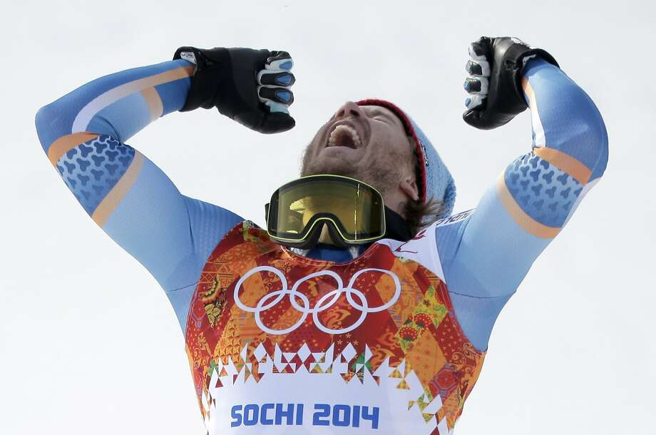 Norway's Kjetil Jansrud celebrates on the podium after winning the gold medal in the men's super-G at the Sochi 2014 Winter Olympics, Sunday, Feb. 16, 2014, in Krasnaya Polyana, Russia. (AP Photo/Charlie Riedel) Photo: Charlie Riedel, Associated Press