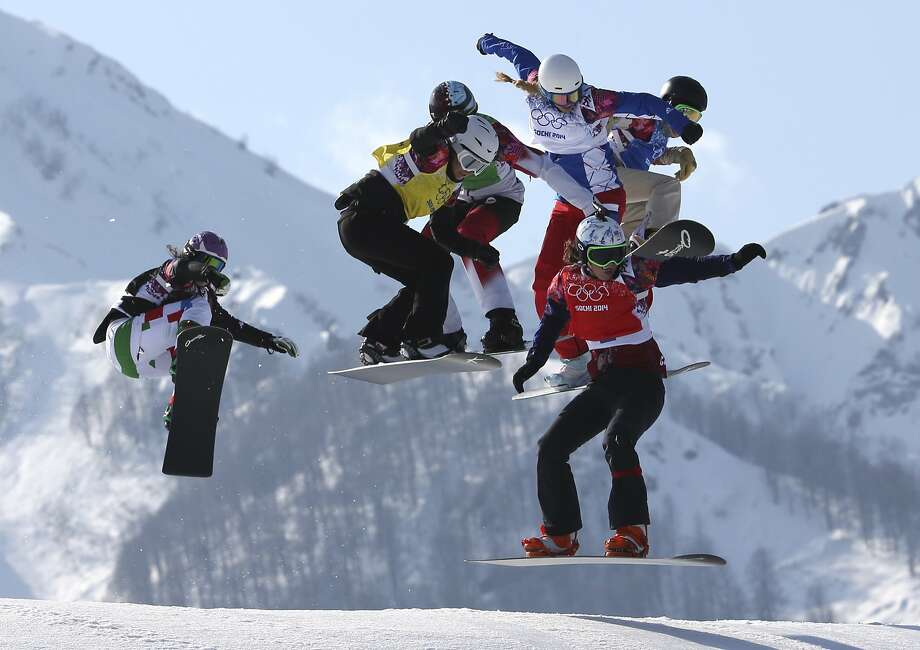 Czech Republic's Eva Samkova, bottom right, leads the field in the women's snowboard cross final at the Rosa Khutor Extreme Park, at the 2014 Winter Olympics, Sunday, Feb. 16, 2014, in Krasnaya Polyana, Russia. Samkova went on to win the gold medal. The other boarders are, from left, Italy's Michela Moioli, Bulgaria's Alexandra Jekova, Canada's Dominique Maltais, France's Chloe Trespeuch, and United States' Faye Gulini. Photo: Luca Bruno, Associated Press