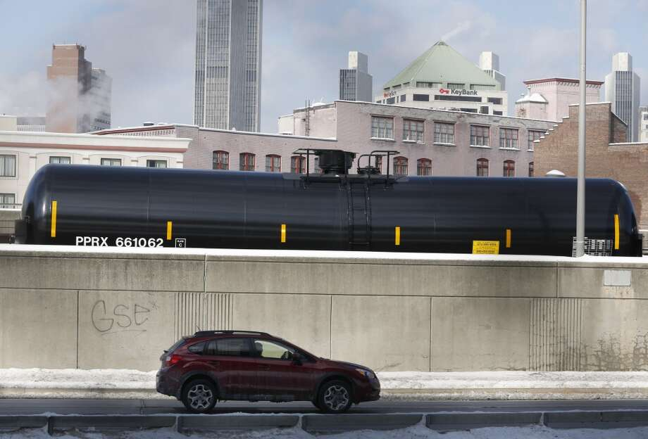 A railroad oil tanker car is parked along Interstate 787 in downtown Albany, N.Y., on Friday, Feb. 7, 2014. The Port of Albany has become a hub for the U.S. oil business, taking shipments from North Dakota's Bakken Shale daily by mile-long trains and shipping it in tankers down the Hudson River to refineries. Opponents of a proposal to build boilers to liquefy heavy crude passing through Albany by rail are drawing attention to the capital's emergence as a major hub for the transport of oil that's widely considered risky from an environmental and safety standpoint.  (AP Photo/Mike Groll) Photo: Mike Groll, AP