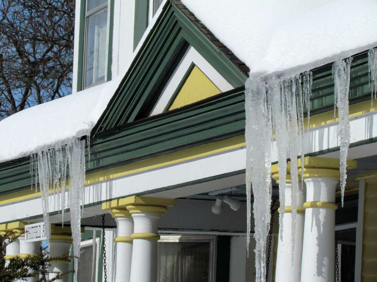 The cottages and Victorians of Round Lake create a colorful backdrop for impressive icicle sculptures that formed in the wake of last week's heavy snowfall.