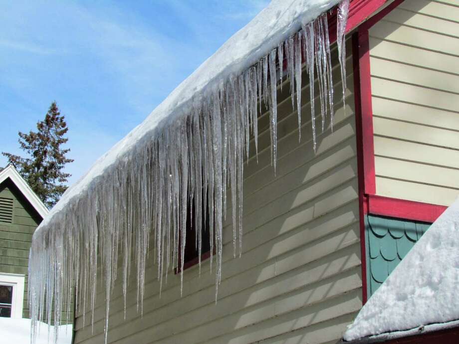 And in case you think the icicle problem we are experiencing this winter is unique, take a look at these photos shot in Round Lake last winter.The cottages and Victorians of Round Lake create a colorful backdrop for impressive icicle sculptures that formed in the wake of last week's heavy snowfall. Photo: Paul Block