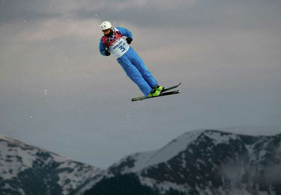Anton Kushnir of Belarus jumps during men's freestyle skiing aerials qualifying at the Rosa Khutor Extreme Park, at the 2014 Winter Olympics, Monday, Feb. 17, 2014, in Krasnaya Polyana, Russia. Photo: Sergei Grits, AP / AP
